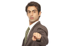 Business man pointing finger at you. Young business man pointing finger at you isolated on white stock photography