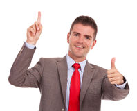 Business man pointing and gesturing ok Royalty Free Stock Photo