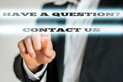 Business Man Pointing on Glowing Contact Us Texts Royalty Free Stock Photography
