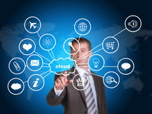 Business man pointing her finger at cloud with. Computer icons. Technology concept. World map as backdrop royalty free stock images