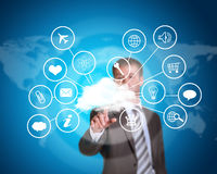 Business man pointing her finger at cloud with Royalty Free Stock Photos