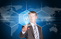 Business man pointing her finger at light bulb Stock Photos