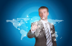 Business man pointing her finger at network icons Royalty Free Stock Photo
