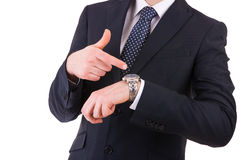 Businessman pointing at his wristwatch. Business man pointing at his wristwatch Royalty Free Stock Photography