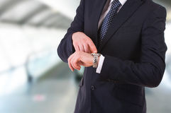 Businessman pointing at his wristwatch. Royalty Free Stock Photography