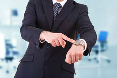Businessman pointing at his wristwatch. Business man pointing at his wristwatch Royalty Free Stock Photo