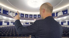 Business man pointing with index finger on presentation screen in meeting hall. Business man pointing with index finger on presentation screen in empty meeting stock video footage