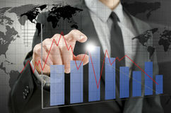 Business man pointing at interactive business graph. Detail of business man pointing at interactive business graph Stock Photo