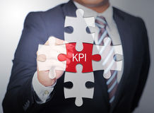 Business Man pointing on jigsaw written word KPI Royalty Free Stock Photography