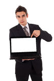 Business man pointing at a laptop Royalty Free Stock Image