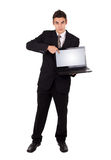 Business man pointing at a laptop computer Stock Image