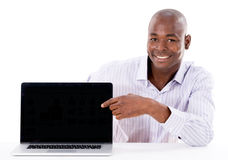 Business man pointing at a laptop Royalty Free Stock Photo