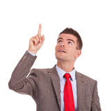 Business man pointing and looking up Stock Images