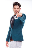 Business man pointing at something interesting on a white Royalty Free Stock Photos