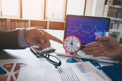 Business man is pointing time to leader financial results. Business man is pointing time to leader financial results Stock Images
