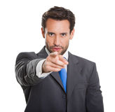 Business man pointing to camera. With his finger royalty free stock image