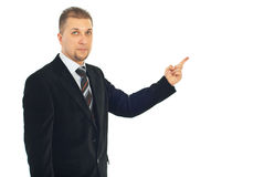 Business man pointing to copy Stock Photos