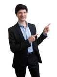 Business man pointing to copy space Royalty Free Stock Photo