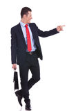 Business man pointing to his side Stock Photography