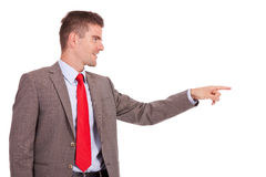 Business man pointing to his side Royalty Free Stock Images