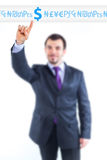 Business man pointing to money graph Stock Photo