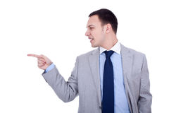 Business man pointing to the side Royalty Free Stock Photography