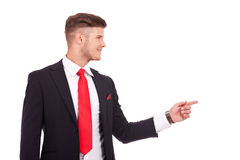 Business man pointing to side Stock Photos