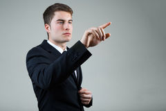 Business man with pointing to something or touching a screen. Stock Photography