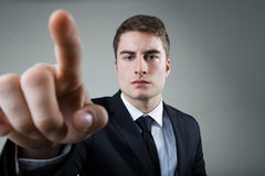 Business man with pointing to something or touching a screen. Royalty Free Stock Image