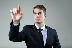 Business man with pointing to something or touching a screen. Royalty Free Stock Images
