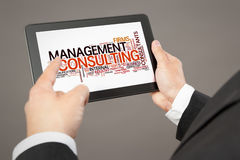 Business man pointing to a tablet pc Royalty Free Stock Photo