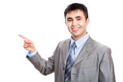 Business man pointing to white background Royalty Free Stock Images