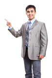 Business man pointing to white background Stock Photos