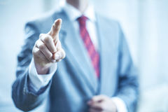 Business man pointing towards camera stock images