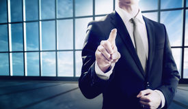 Business man pointing towards camera Stock Photo