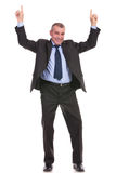 Business man pointing up with both hands Stock Photo
