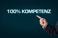 Business man pointing at the words 100% competence Stock Photo