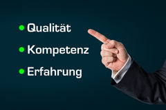 Business man pointing at the words -Quality, Competence, Experie Royalty Free Stock Photos