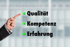 Business man pointing at the words, Quality-Competence-Experienc Stock Photos