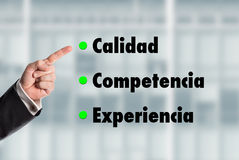 Business man pointing at the words, Quality-Competence-Experienc Stock Photo