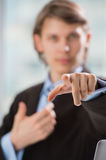 Business man pointing at you blurred Royalty Free Stock Photo
