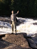 Business man pointing2. Business man pointing outside standing next to river shot in hard natural light Royalty Free Stock Photos