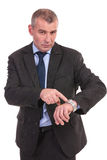 Business man points at his watch Royalty Free Stock Photo