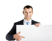 Business man points at paper copyspace Stock Photos