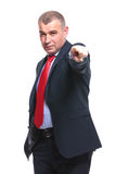 Business man points toward you Stock Photo