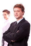 Business man portrait business woman in background Stock Image