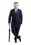 Business man posing with an umbrella Royalty Free Stock Photos