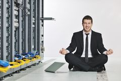 Business man practice yoga at network server room Royalty Free Stock Photo