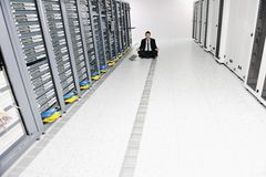 Business man practice yoga at network server room Stock Photo