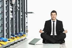 Business man practice yoga at network server room royalty free stock image